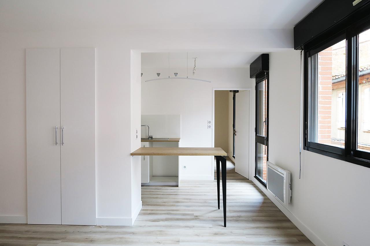 Vue séjour cuisine de jour rénovation appartement j